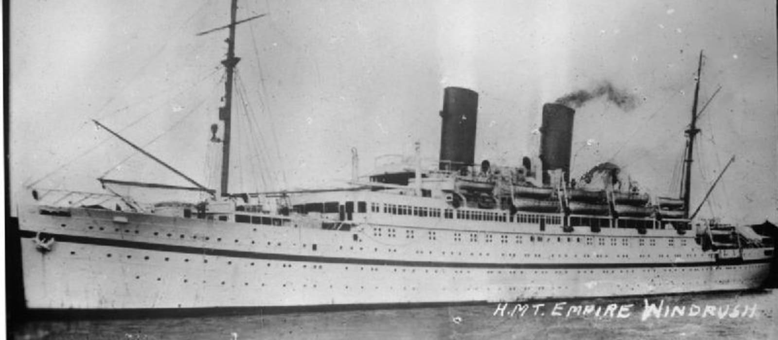 A black and white photograph of the ship the Empire Windrush